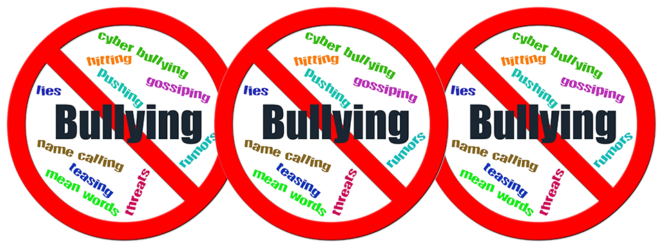 Photo of a red circle with the word 'Bullying' in the center of it and a red line going diagonally through the word 'Bullying'. In the background of the circle are words like pushing, hitting, threats, name calling, etc. There are three of these circles side by side.