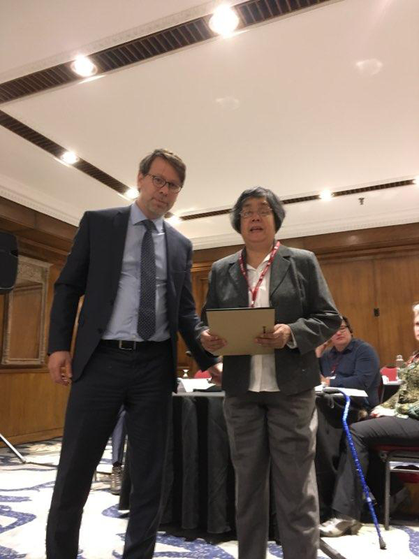 Advisory Group for Disability Issues Meeting Picture. November 20th 2018. S. Perrault and D. Jodhan holding certificate.