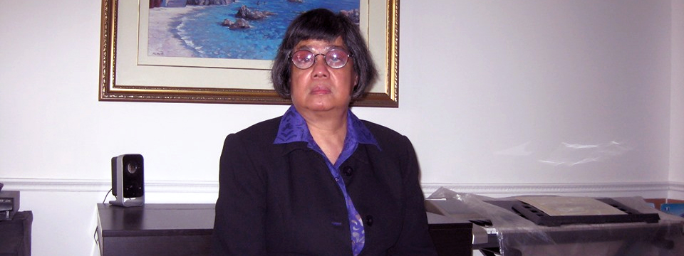 Donna Jodhan in a suit. Sitting. Facing the camera.