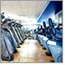 Photo of a beautiful gym with rows and rows of different machines.