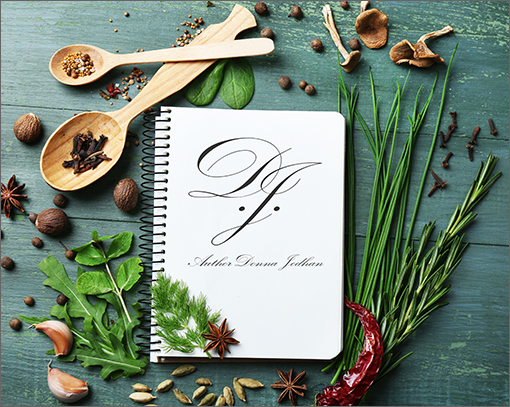 Author Donna Jodhan Recipe Library Subscription Logo: On top of an aged wooden table sits a color collection of many different dried spices all decoratively surrounding a single spiral notebook in the center of the photo. This notebook is open to a blank page, upon which sits the Author Donna Jodhan logo, directly in the center. Welcome to the Author Donna Jodhan Recipe Library Subscription.